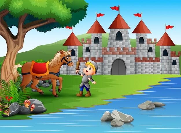 Mały rycerz walczy z koniem w krajobrazie zamku