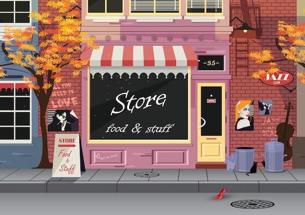 Mały sklep na starej ulicy miasta, jesień.