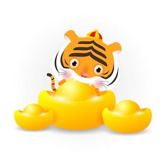 Mały tygrys trzyma chińskie sztabki złota