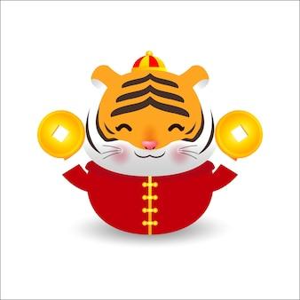 Mały tygrys z trzymającymi chińskie sztabki złota i szczęśliwego chińskiego nowego roku 2022 roku z kreskówki zodiaku tygrysa.