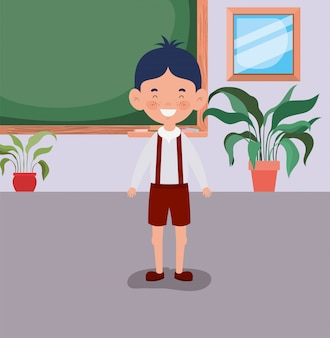 Mały uczeń chłopiec w klasie