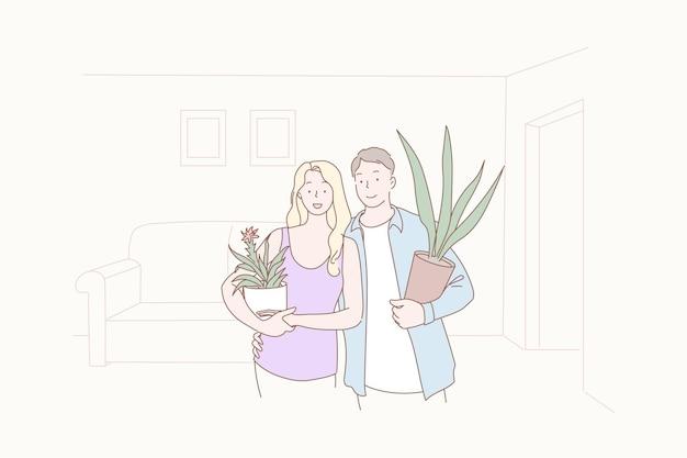 Małżeństwo dokonujące przesiedlenia mieszkania z roślinami