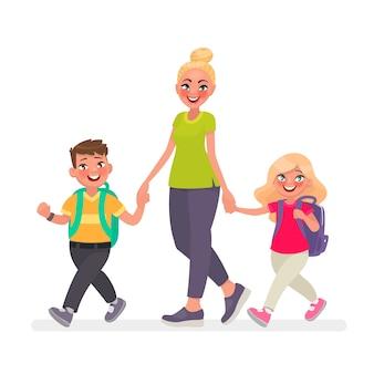 Mama idzie z dziećmi do szkoły. dzieci ze szkoły podstawowej i matka razem