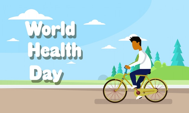 Man riding bike over world health day