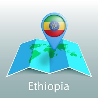 Mapa świata flaga etiopii w pin z nazwą kraju na szarym tle