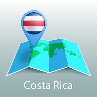 Mapa świata flaga kostaryki w pin z nazwą kraju na szarym tle