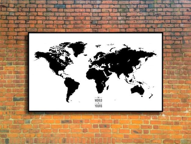 Mapa świata w ramce na tle ceglanego muru w stylu loft.