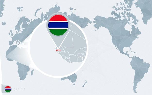 Mapa świata wyśrodkowanego na pacyfiku z powiększoną gambią. flaga i mapa gambii.