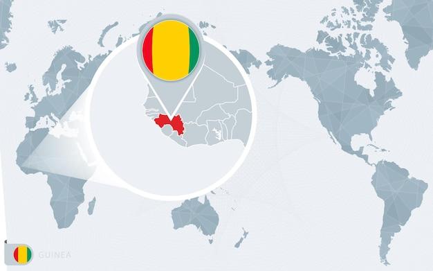 Mapa świata wyśrodkowanego na pacyfiku z powiększoną gwineą. flaga i mapa gwinei.