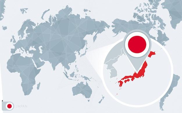 Mapa świata wyśrodkowanego na pacyfiku z powiększoną japonią. flaga i mapa japonii.