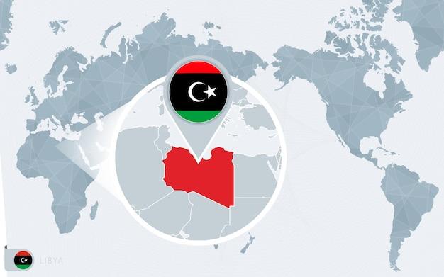 Mapa świata wyśrodkowanego na pacyfiku z powiększoną libią. flaga i mapa libii.