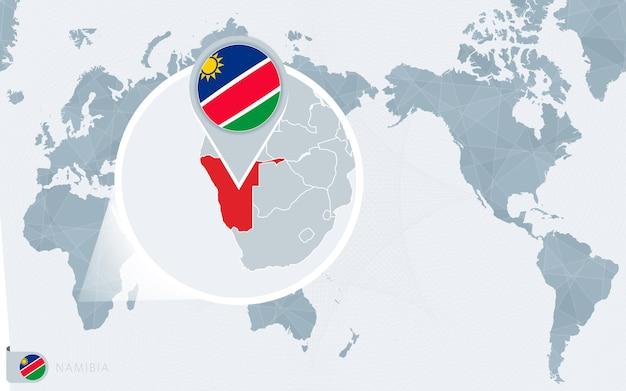 Mapa świata wyśrodkowanego na pacyfiku z powiększoną namibią. flaga i mapa namibii.