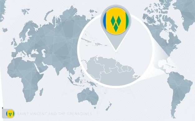 Mapa świata wyśrodkowanego na pacyfiku z powiększonym saint vincent i grenadynami. flaga i mapa saint vincent i grenadyn.