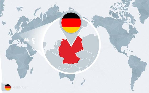 Mapa świata wyśrodkowanego na pacyfiku z powiększonymi niemcami. flaga i mapa niemiec.