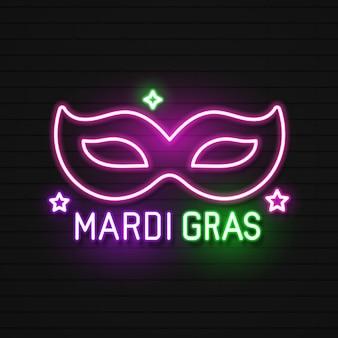 Mardi gras masquerade mask. błyszczące lampy neonowe świecą stylizacją na czarnym murem.