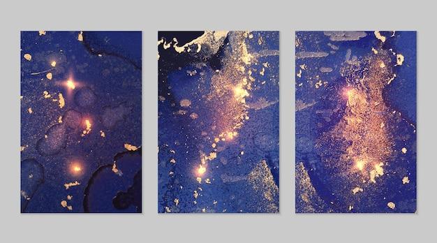 Marmurowy zestaw dżinsowych niebieskich i złotych abstrakcyjnych tła z brokatem w technice atramentu alkoholowego