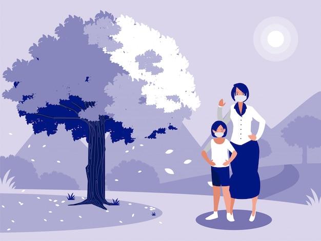 Matka i córka z maską przed krajobrazem