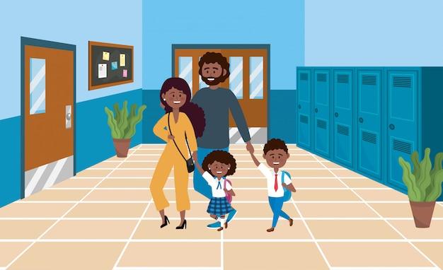 Matka i ojciec z uczniami z chłopca i dziewczynki