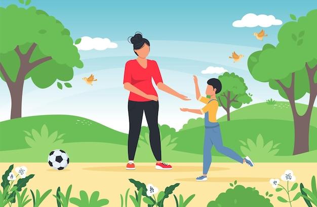Matka spędza wolny czas letni na świeżym powietrzu bawiąc się z dzieckiem