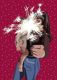 Matka z dzieckiem w ramionach trzyma płonące światełka sylwestrowe