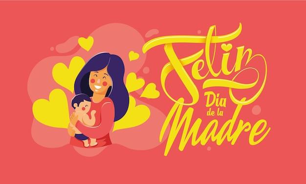 """Matka z synkiem, z przesłaniem """"szczęśliwego dnia matki"""" w języku hiszpańskim feliz da de la madre."""