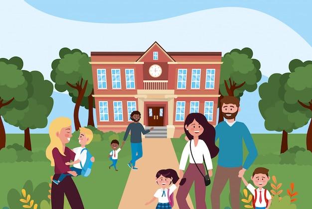 Matki i ojciec ze swoimi chłopcami i uczniami w szkole