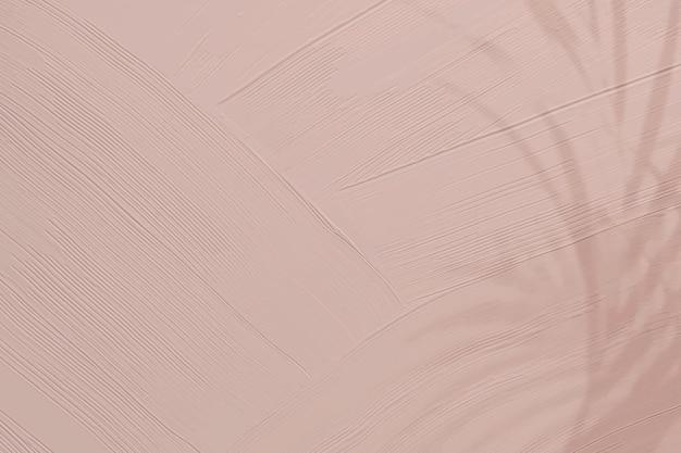 Matowe różowe tło tekstury farby z cieniem liści