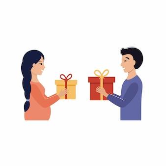Mąż i żona dają prezent para w ciąży świętuje nowy rok i boże narodzenie