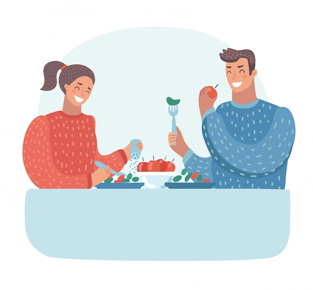 Mąż i żona jedzą obiad. rodzinny obiad. wegetarianizm