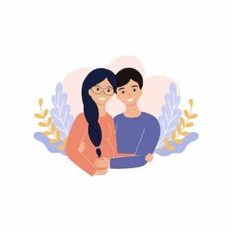 Mąż obejmuje swoją ciężarną żonę na tle gałęzi i kwiatów. mężczyzna i kobieta w ciąży. małżeństwo czekające na narodziny dziecka.