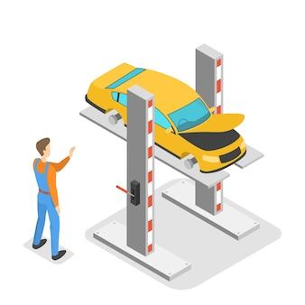 Mechanik naprawia żółty samochód na podnośniku