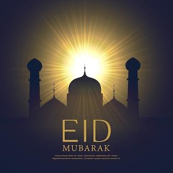 Meczet sylwetka z rozżarzonego światła eid mubarak festiwal tle