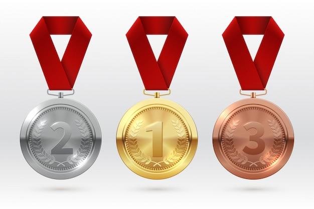 Medale sportowe. złoty srebrny brązowy medal z czerwoną wstążką. mistrz zwycięzca nagrody honorowe na białym tle szablon