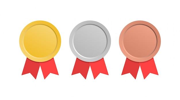 Medale złoty, srebrny i brązowy medal. medale z czerwonymi wstążkami.