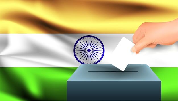 Męska ręka odkłada białą kartkę papieru ze znakiem jako symbolem karty do głosowania na tle flagi indii. indie symbolem wyborów