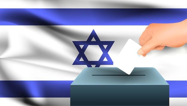 Męska ręka odkłada białą kartkę papieru ze znakiem jako symbolem karty do głosowania na tle flagi izraela. izrael symbolem wyborów