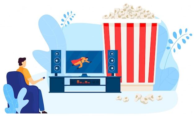 Męski charakter ogląda domowego kino, duży popkornu pudełko na białym, ilustracja. mężczyzna patrzy na ekran telewizora.