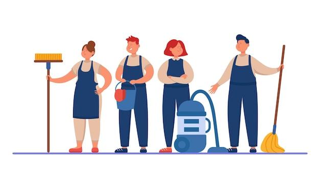 Męski i żeński personel sprzątający z mopami i odkurzaczem