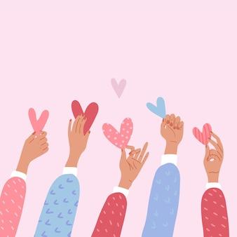Męskie lub kobiece ręce trzymając serca.