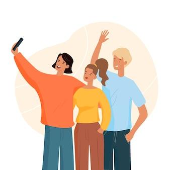 Mężczyzna bierze selfie z przyjaciółmi