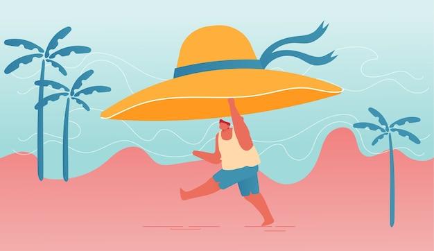 Mężczyzna charakter trzyma ogromny tropikalny kapelusz