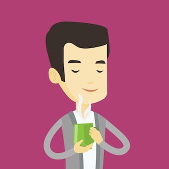 Mężczyzna cieszy się filiżankę kawy.