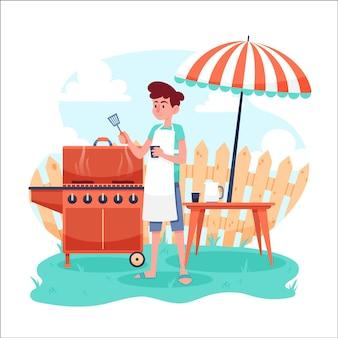 Mężczyzna co grill na swoim podwórku