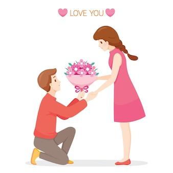 Mężczyzna daje kobieta bukiety kwiatów na walentynki