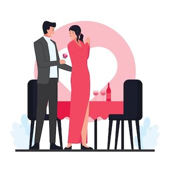 Mężczyzna daje kwiat kobiecie podczas walentynkowej kolacji.
