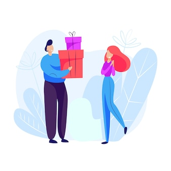 Mężczyzna daje prezenty kobiecie