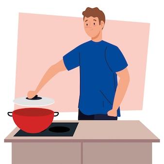Mężczyzna gotuje z garnkiem na scenie w kuchni