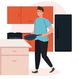 Mężczyzna gotuje z patelni na scenie kuchni