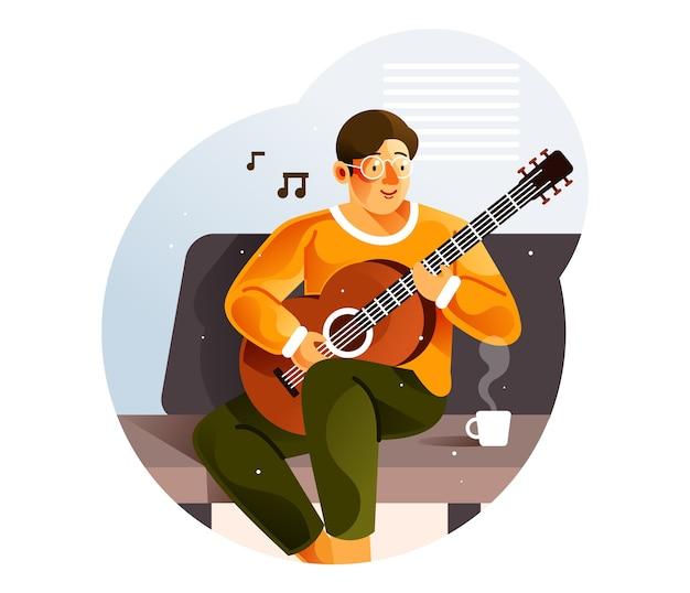 Mężczyzna gra na gitarze siedząc na kanapie