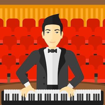 Mężczyzna gra na pianinie.